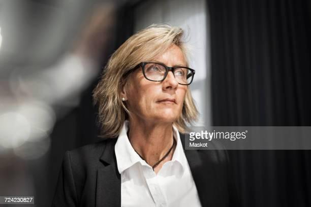 Mature businesswoman standing in hotel room