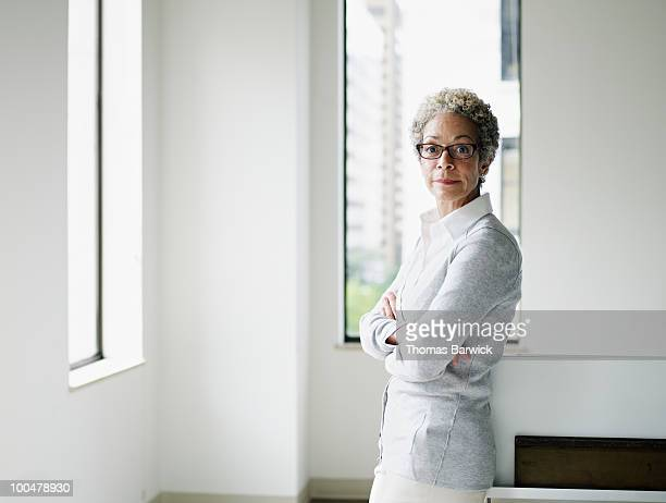 Mature businesswoman standing in office