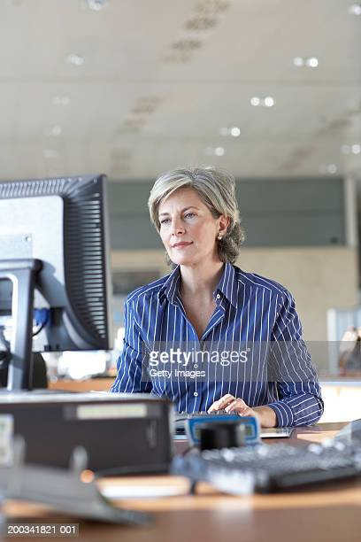 Mature businesswoman using computer in office