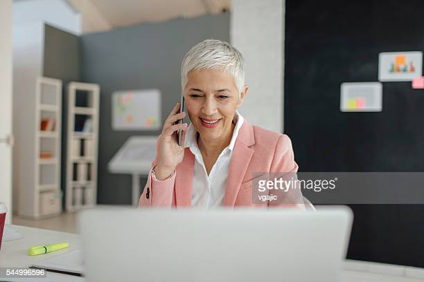 Mature Businesswoman Working In Her Office.
