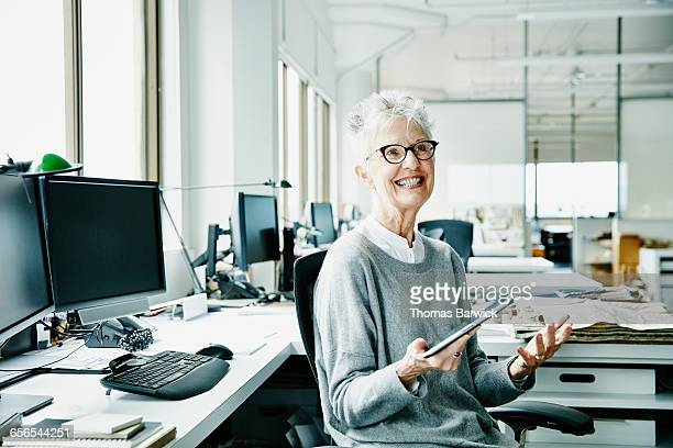 Mature businesswoman working on digital tablet