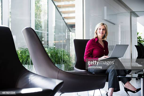 Mature businesswoman working on laptop