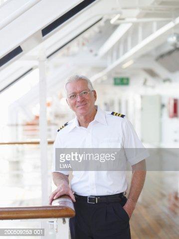 Mature captain on cruise ship, smiling, portrait
