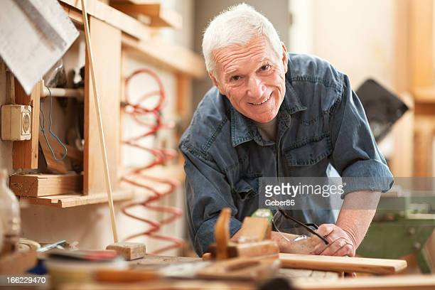 Mature carpenter at work