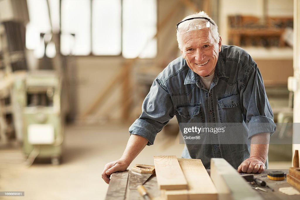 Mature carpenter at work : Stock Photo