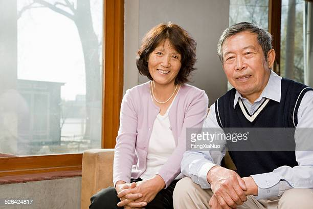 Mature Chinese Couple Sitting