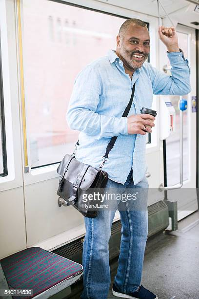 Mature Commuter Taking Public Transit