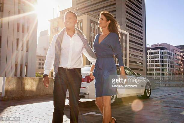Mature couple arriving at the city