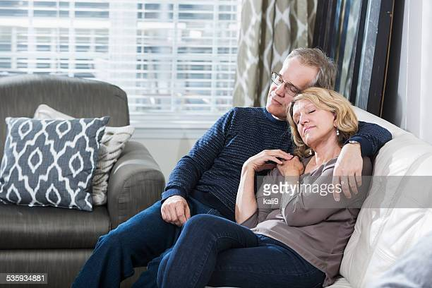 Mature couple asleep on the couch