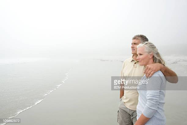 Mature couple at the beach enjoying view
