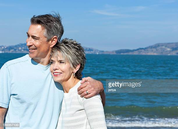 mature couple at water's edge