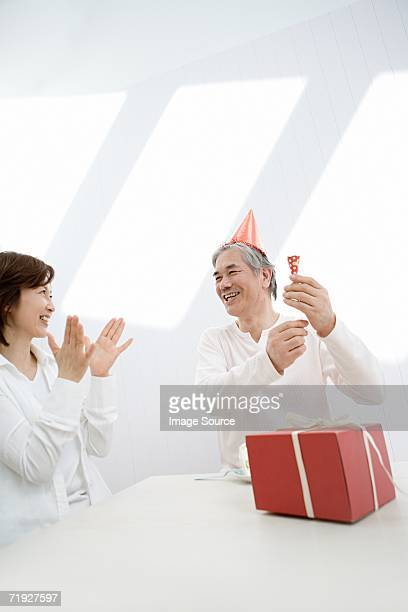 Mature couple celebrating birthday
