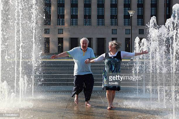 mature couple dance in fountains