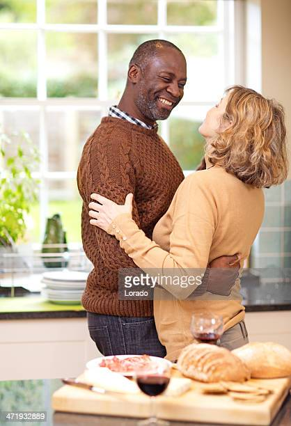 mature couple dancing at the kitchen