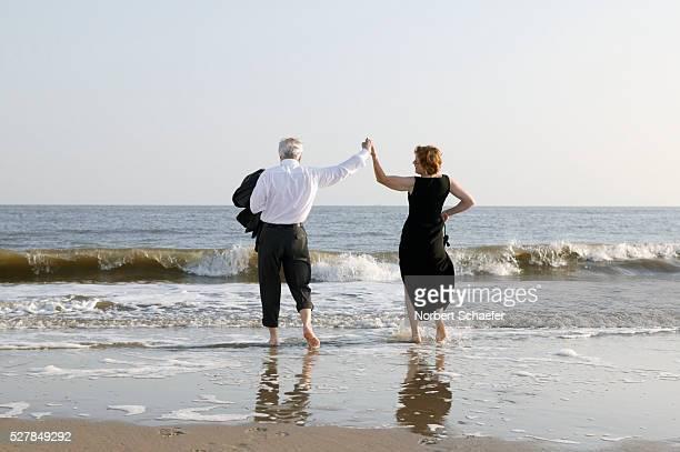 Mature Couple Dancing on Sea Shore