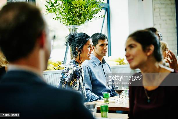 Mature couple dining with friends in restaurant