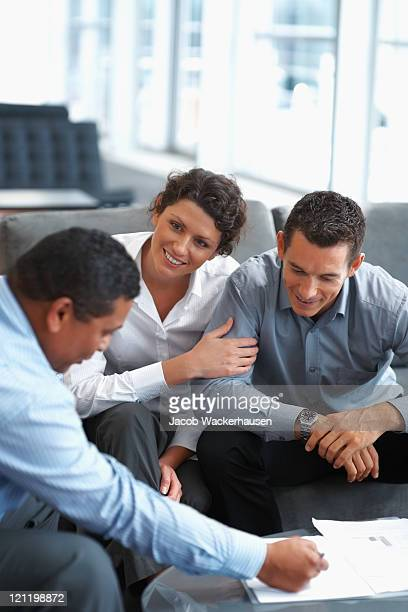 Mature couple discussing investment plans with a consultant