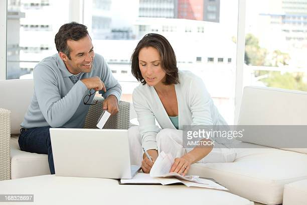 Mature couple doing home finances at home