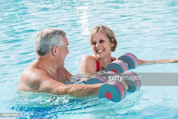 Mature couple doing water aerobics