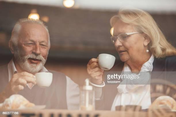 Mature couple drinking coffee