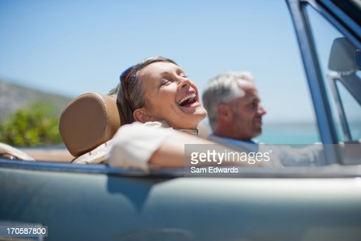 Mature couple driving in convertible : Stock Photo
