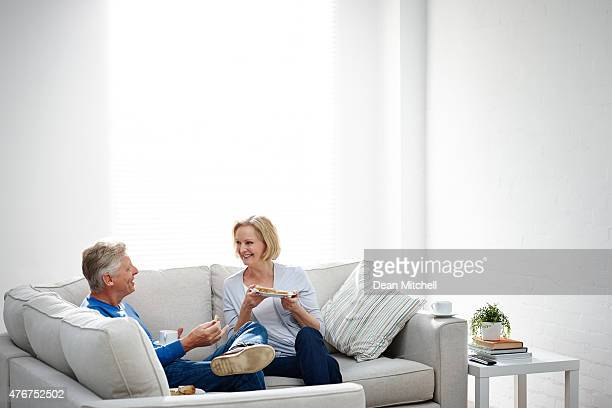 Mature couple eating supper in living room