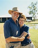 Mature couple embracing at desert lodge, portrait
