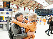 mature couple embracing at railway station.