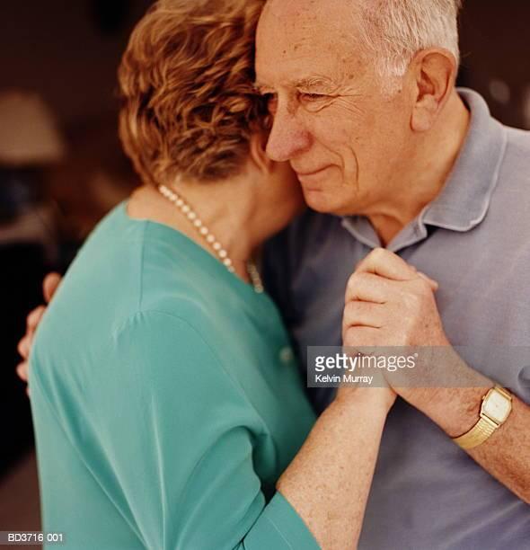 Mature couple embracing, close-up