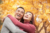 Mature Couple Embracing in Park