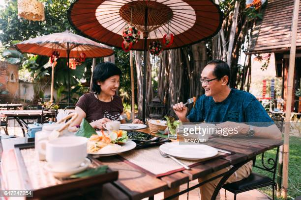 Mature couple enjoy lunch on their vacations in Southeast Asia