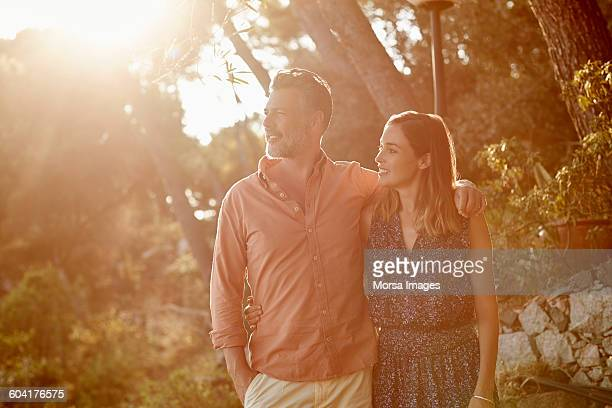Mature couple enjoying summer vacation in forest