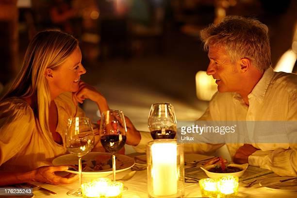 Mature couple having a romantic candle light dinner