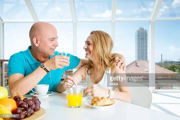 Mature couple having breakfast