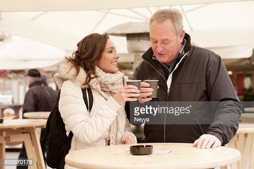 mature couple having coffee outdoors : Stock Photo