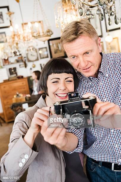 Mature Couple Having Fun In Antique Store