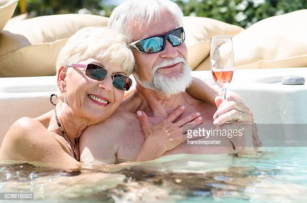 mature couple having fun togetherness in the pool