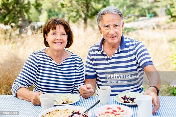 Mature couple having meal outdoor