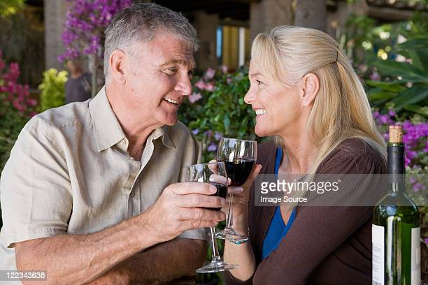 Mature couple having red wine