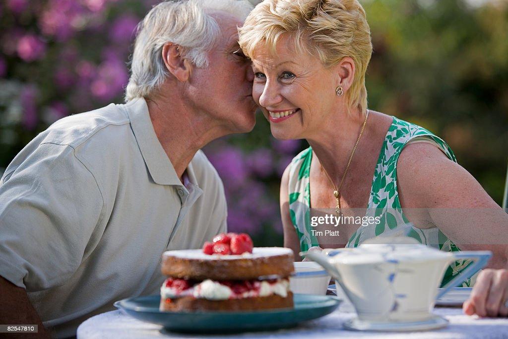 Mature couple having tea in the garden. : Stock Photo