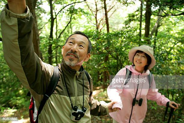 Mature couple hiking in a park, close-up