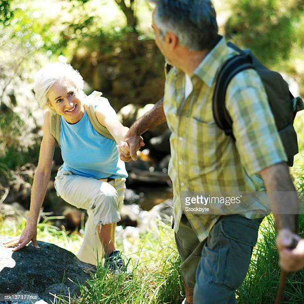 mature couple hiking in the woods