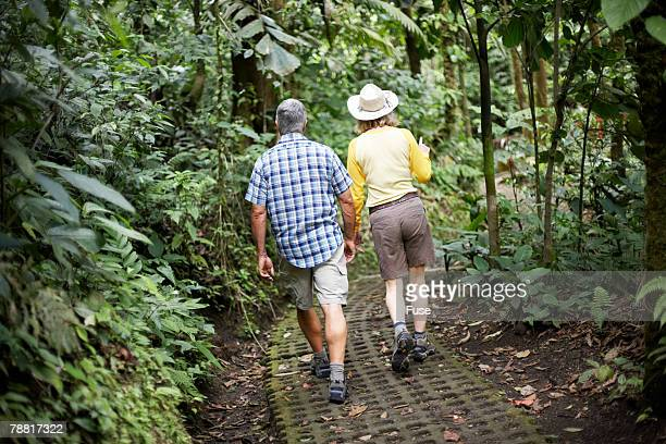 Mature Couple Hiking in Wilderness Area
