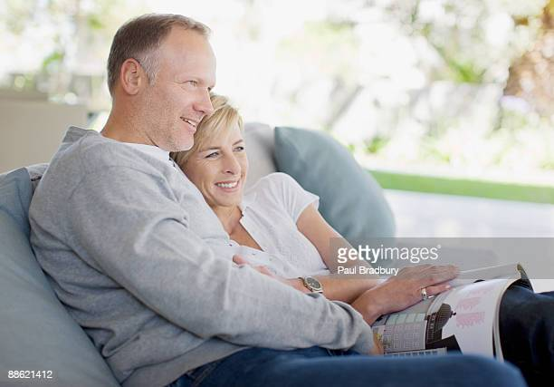 Mature couple hugging on sofa