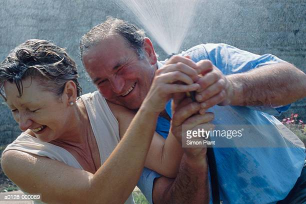 Mature Couple in a Waterfight