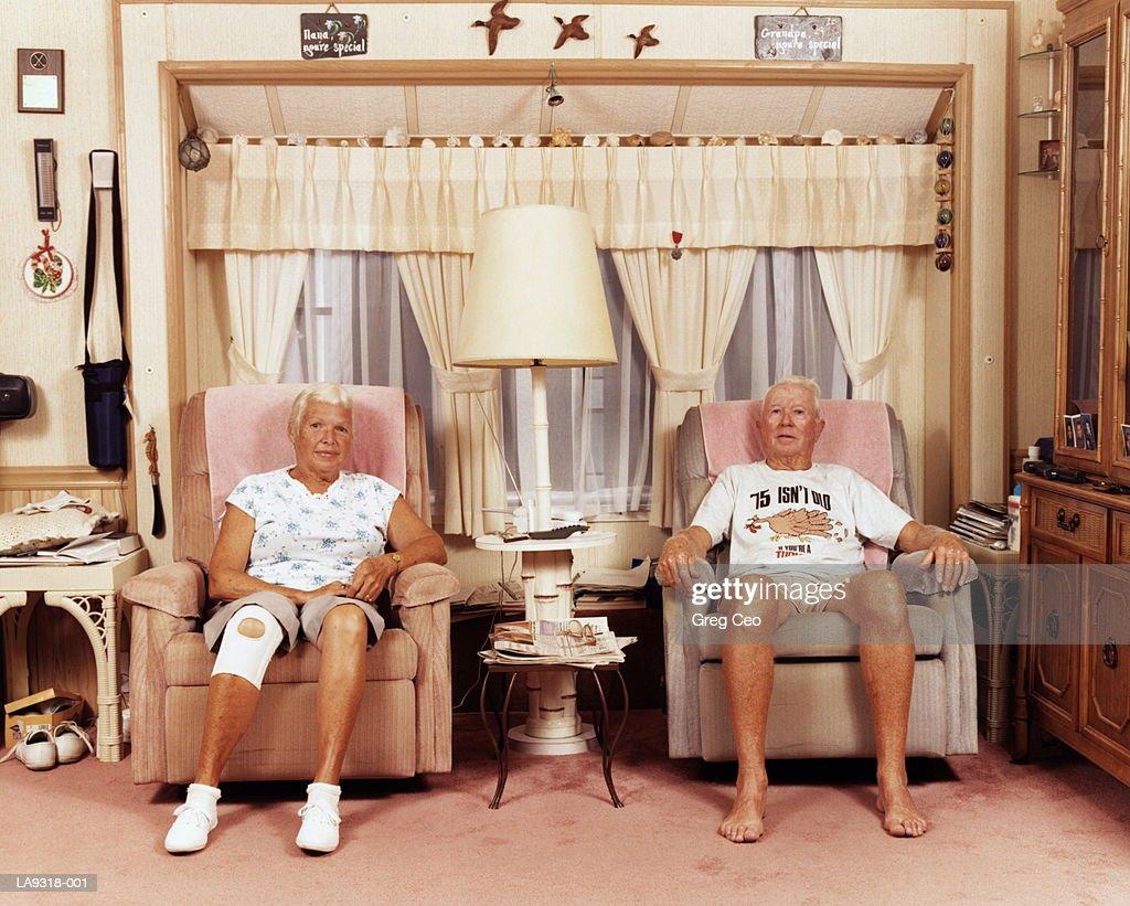 Mature couple in armchairs, portrait