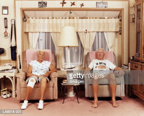 Mature couple in armchairs, portrait : Stock Photo