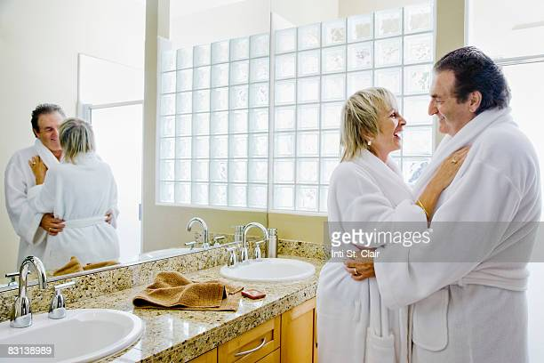 Mature Couple in Bathroom Embracing, Laughing