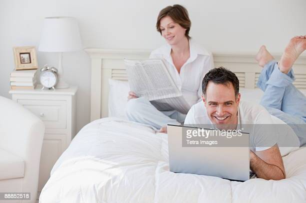 Mature couple in bed in the morning