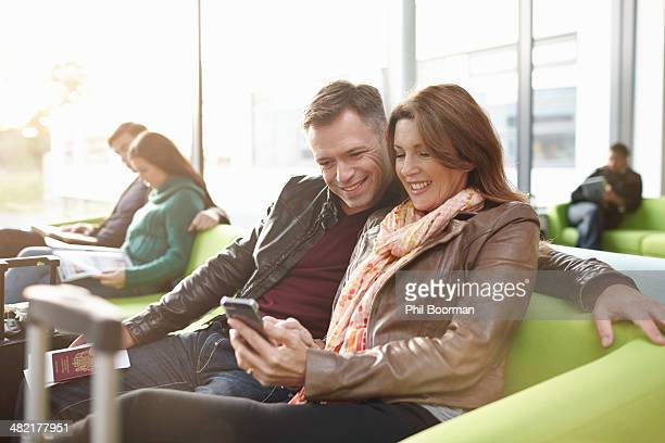 Mature couple in departure lounge